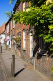 A typical English street in summer. View of an idyllic street in a small town in Oxfordshire, England Stock Photography