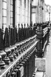 Typical English style - iron fences in front of the house Royalty Free Stock Photo