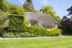 Typical English thatched roof cottage. Minehead, Somerset, England - May 23, 2015 : Typical thatched roof cottage in rual England Royalty Free Stock Photos