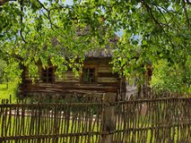 Typical, ethnographic wooden house. Typical, antic, ethnographic wooden house in Rumsiskes, Kaunas district in Lithuania Stock Image