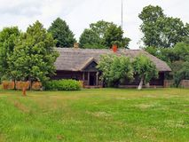 Typical, ethnographic wooden house. Typical, antic, ethnographic wooden house in Rumsiskes, Kaunas district in Lithuania Stock Photo