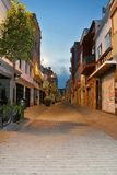 A typical evening alley in the old part of Malgrat de Mar. Footpath, street, lamp, sky and romantic atmosphere Royalty Free Stock Photos