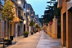 A typical evening alley in the old part of Malgrat de Mar. Footpath, street, lamp, sky and romantic atmosphere Royalty Free Stock Image