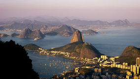 Typical evening in Rio. Typical amazing sky of Rio de Janeiro in the evening. It features the Sugarloaf mountain in the center the a mountain chain in the royalty free stock photos