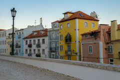Typical exterior of old houses in a narrow street in Lisbon Stock Images