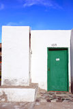Typical facade of a dwelling on Lanzarote, with white walls and green door Stock Photography