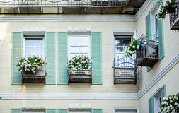 Typical facade of the old Provencal retro house with windows and wooden shutters Stock Photos