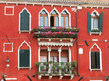 Typical facade in Venice with decorative flowers. Stock Photography