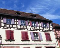 Typical fachwerk house at Riquewihr. Alsace, France .Timbered house with burgundy windows stock photos