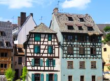 Typical fachwerk houses at Strasbourg, Alsace, France. Typical fachwerk houses with timbered and colorful windows. Strasbourg, Alsace, France. Timbered house royalty free stock photo