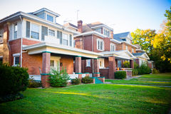 Typical Family Homes. Large brick homes with large windows and front porches Stock Photos