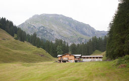 Typical farm in the Swiss alps Stock Photos
