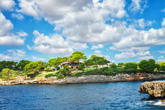 Typical farmhouse on the coast of Mallorca island. Royalty Free Stock Photos