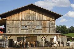 Typical farmhouse in Pusteria valley, Italy. Barn and horse stables in southern Tyrol, Italy Stock Image