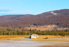 Typical farmhouse in West Virginia. A lonely farmhouse on a sunny winter day with forestry hills in the background Stock Photography