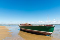 Arcachon Bay, France, typical fishing boat. A typical fishing boat of the Arcachon Bay at low tide Royalty Free Stock Photography