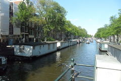 Typical floating house in Amsterdam in the Netherlands. Typical floating house in Amsterdam canals in the Netherlands An emblem of the Netherlands. People live stock image