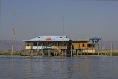 Typical floating houses on Inle Lake, Myanmar. Stock Photo
