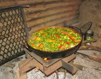 Typical food cooked with chicken wood with peppers and peas stock images