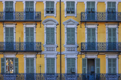 Typical french architecture with balcony. Typical french architecture in Nice, France. Frontal symmetrical shot Royalty Free Stock Photography