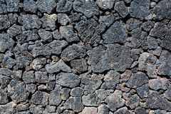 Typical volcanic rock stone wall, Lanzarote, Spain royalty free stock photography