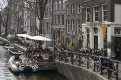 Typical gabled houses on Damrak street in Amsterdam, Holland, Netherlands Stock Photo