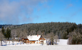 Typical german house in snowy landscape Stock Photography