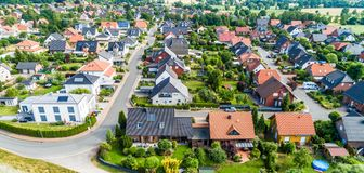 Typical German new housing development in the flat countryside of northern Germany between a forest and fields and meadows royalty free stock photography
