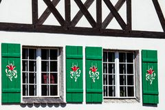 Typical germany windows with green shutters and window box Stock Photos