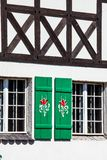 Typical germany windows with green shutters and window box Royalty Free Stock Photos
