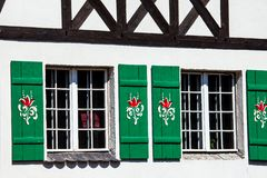 Typical germany windows with green shutters and window box Royalty Free Stock Photography