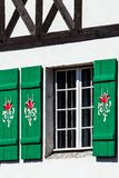 Typical germany windows with green shutters and window box Royalty Free Stock Images