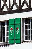 Typical germany windows with green shutters and window box Stock Photography