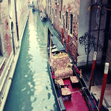 Typical gondola at narrow venetian canal, Venice, Italy. Royalty Free Stock Photos