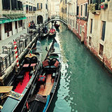 Typical gondola at narrow venetian canal, Venice, Italy. Stock Photo