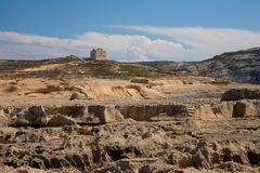 Typical Gozo landscape. With cliffs and an old fort Stock Images