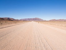 Typical gravel road in Namibia. Stock Photo
