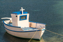 Typical greek boat anchored in the port.  Stock Image