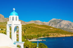 Typical Greek church with blue dome and sea Greece Royalty Free Stock Photos