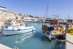 Typical Greek colorful fishing boats in the harbour of Vlychada, Santorini, Greece stock image