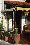 Typical Greek garden with flower pots with flowers and plants. Royalty Free Stock Photos