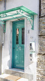 Typical greek  house facade with green wooden door Stock Photos