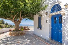 Typical greek house nwxt to the tree. Beautiful view stock photos