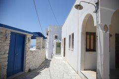 Typical greek island street in Tinos, Greece Royalty Free Stock Image