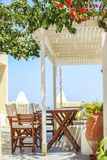 Typical Greek outdoor cafes on the island of Royalty Free Stock Images
