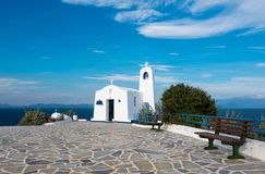 White small orthodox chapel dedicated to St Nikolao. Typical greek place with a white small orthodox chapel dedicated to St Nikolaos.Rafina,Greece Stock Photos