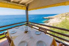 Traditional chairs with a table near the beautiful Greek sea at Zakynthos island in Greece royalty free stock image