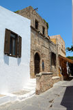 Typical greek street, Lindos city, Rhodes island, Greece Royalty Free Stock Images