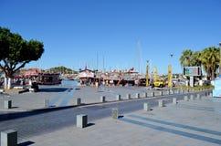 Typical Greek street  with palm trees .Sea port.Kos island ,Greece Royalty Free Stock Photo