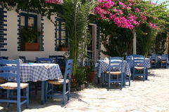 Typical greek taverna. With tables outside in the yard Stock Photos
